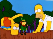 "Homer and a long-necked Bart find the leprechaun they hope will clear the family curse in ""Treehouse of Horror XII."""