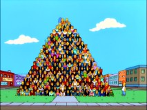 Homer gets ready to scale a giant human pyramid in a failed world record attempt that gets Springfield recognized for different reasons.