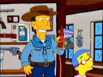 "Old cowboy Buck McCoy lassoes a snack for his new friend Bart but denies Milhouse's banana request in ""The Latest Gun in the West."""