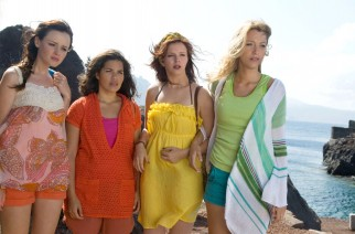 Lena (Alexis Bledel), Carmen (America Ferrera), Tibby (Amber Tamblyn) and Bridget (Blake Lively) stand with all the colors of the rainbow in their bright beach outfits.
