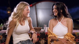 Tank top-wearing Bridget (Blake Lively) shares a laugh with her professor (Shohreh Aghdashloo).