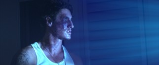 Drawn to the blue light outside, Jarrod (Eric Balfour) gets veiny.