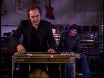 "Daniel Lanois gives a very cool live performance of ""Omni"" from his score as Thornton listens in approval."