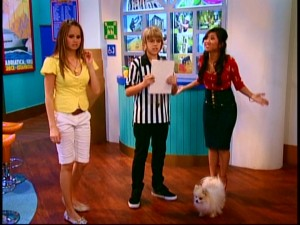 Porkers, the pet pig of Bailey (Debby Ryan), competes with Ivana, the pampered Pomeranian of London Tipton (Brenda Song), to see who's the smarter creature, while Cody (Cole Sprouse) referees in striped uniform.