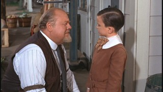 Osh (Burl Ives) has a talk with Peter, who's suspiciously sporting a new 'do.