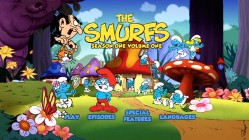 "Typical for a 16x9-enhanced menu, the center of the frame is filled with characters, while the sides feature colorful Smurf Village imagery that's fine to be lost. Disc 1's main menu is identical to this Disc 2 screen, only ""Trailers"" replaces ""Special Features."""