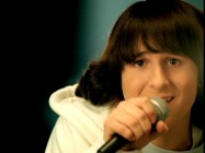 "Mitchel Musso and his hair appear in one of their many extreme close-ups for the video ""Lean on Me."""