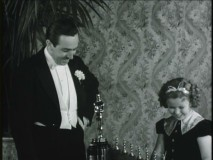 "Walt Disney and Shirley Temple proudly admire his Oscars for ""The One That Started It All."""