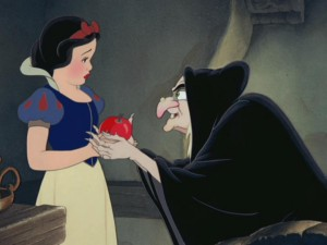 The Queen, disguised as an old peddler woman, hands Snow White the apple of Snow's impending doom.