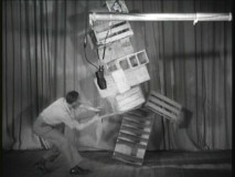 "A foley artist plays jumbo-sized Jenga in order to get the crashing sound effect needed in ""Walt's Early Masters of Sound."""