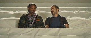 Nathaniel (Jamie Foxx) is not entirely comfortable being back in a concert hall, even when he's there during a practice session with Steve (Robert Downey Jr.) and draped upholstery.