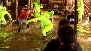 "It takes many men in bright green bodysuits to recreate Mickey Mouse's famous mop scene, ""The Making of 'The Sorcerer's Apprentice'"" reveals."