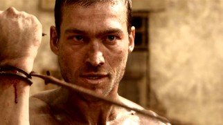 Spartacus (Andy Whitfield), the newest arrival at Batiatus' ludus, catches Doctore's whip on his wrist. So it begins...