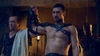 Spartacus' (Andy Whitfield) unparalleled fighting brings honor and fortune to his dominus Batiatus (John Hannah).