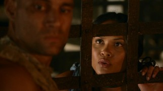 The ludus cell bars aren't enough to keep slave girl Naevia (Lesley-Ann Brandt) away from Crixus (Manu Bennett), Capua's feared and coveted champion.