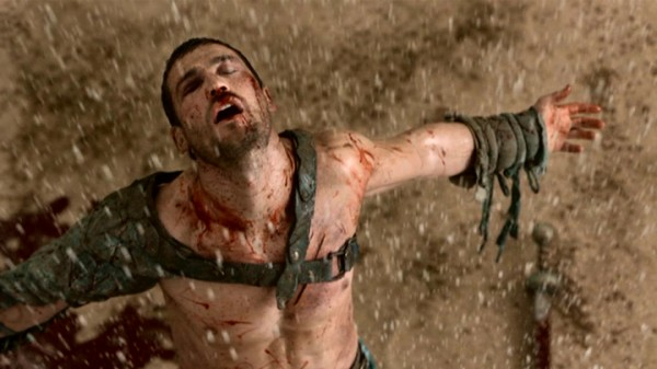 Spartacus (Andy Whitfield) enjoys the feel of falling rain (à la Andy Dufresne) that his longshot victory has evidently brought.
