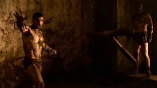 Anything goes in the Pits of the Underworld, as Spartacus (Andy Whitfield) throws his weapon at a malicious, inattentive spectator. In slow motion, of course.