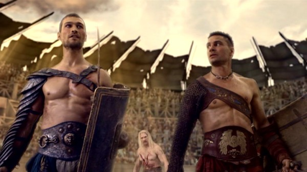 Spartacus (Andy Whitfield) and Crixus (Manu Bennett) soak up the arena's premature praise. Don't celebrate just yet, boys. He is Vigo! You are like the buzzing of flies to him!