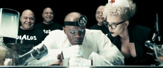 The Octopus (Samuel L. Jackson) is fascinated, his dim-witted bald clones (Louis Lombardi) amused, and assistant Silken Floss (Scarlet Johansson) unimpressed by his latest experiment, a living head on a foot.