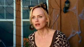 Meow! The children's mother Gillian (Amber Valletta) is a kitty cat woman in the film's Halloween-set climax.