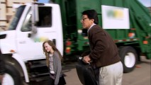 "Add ""Segway Rider"" to ""Stunt Master and Mentor"" as Jackie Chan takes a short ride with a little friend in front of what's clearly not a Waste Management truck."