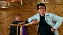 Jackie Chan poses with a chair and a co-star (Lucas Till) in the blooper reel. The same shot's appearance at the start of the end credits displays the film's title logo.