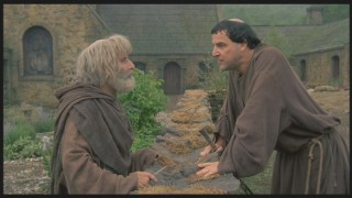 Brother Daniel (Mandy Patinkin, right) insists that Brother Paul allow Squanto to stay with the monks.