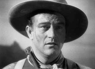 In his superstar-making turn as Henry the Ringo Kid, John Wayne gets one of the all-time great hero's entrances in a shot that ends with this close-up.