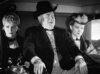 Banker/embezzler Gatewood (Berton Churchill) is large and in charge as he pushes the film's two very different female leads (Claire Trevor, Louise Platt) up into the stagecoach's corners.