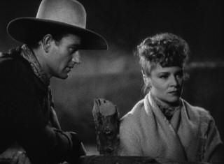 Outside the ranch where the group temporarily sets up, Ringo (John Wayne) and Dallas (Claire Trevor) have a talk about their futures.