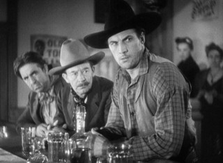 Luke Plummer (Tom Tyler, right) and his brothers can be found in Lordsburg, the stagecoach's final stop on the revenge line.