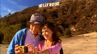 On their day of L.A. sightseeing, Christopher (Sterling Knight) and Jessica (Danielle Campbell) make sure to take a picture of themselves by the landmark Hollywood sign.