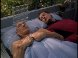 "No, this isn't a deleted scene or a behind-the-scenes featurette... it's just an awkward encounter between Captain Picard (Patrick Stewart) and Q (John de Lancie) in ""Tapestry."""