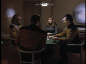 "Worf, Dr. Crusher, Data, and Riker sit down for a repetitive poker game in ""Cause and Effect."""