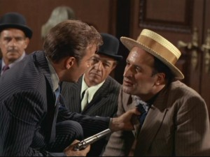 "Kirk gets into the gangster spirit as he holds crime boss Jojo Krakow (Vic Tayback) by the tie at gunpoint in ""A Piece of the Action."""