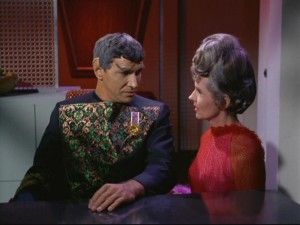 Even after being married to him for quite some time, Amanda (Jane Wyatt) still can't bring herself to understand the unfeeling ways of her Vulcan husband Sarek (Mark Lenard) and his people.