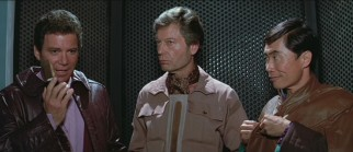 "Kirk (William Shatner) calls for reinforcements while Bones (DeForest Kelley) temporarily zones out, and Sulu (George Takei) fixes his wardrobe after a tussle in ""Star Trek III: The Search for Spock."""