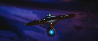 The USS Enterprise attempts to locate Khan through a thick purplish nebula.