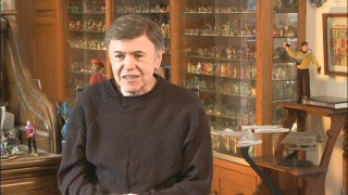"Original cast member Walter Koenig, surrounded by replicas of himself and other Star Trek people and things, recollects ""Pavel Chekov's Screen Moments."""