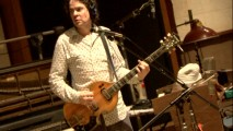 "Composer Jon Brion plays guitar in the featurette that celebrates his ""Step Brothers"" music."