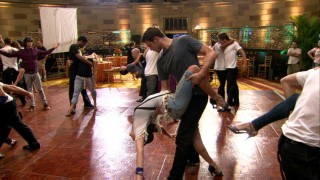 """Extra Moves"" shows the dance crew practicing the tango in casual wear."