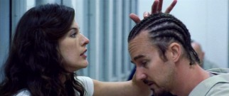 On a prison visit, Lucetta (Milla Jovovich) admires her husband's (Edward Norton) well-groomed cornrows.