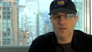 Director/co-writer Paul Ziller displays respect Syfy's legacy with the old-school Sci-Fi Channel cap he wears in the behind the scenes featurette.
