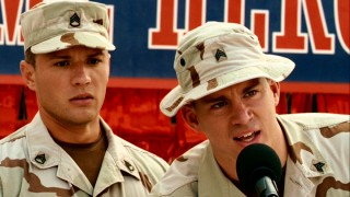 At the Brazos, Texas parade thrown for their return, Steve Shriver (Channing Tatum, right) steps in to help best pal Brandon King (Ryan Phillippe) with his impromptu speech.