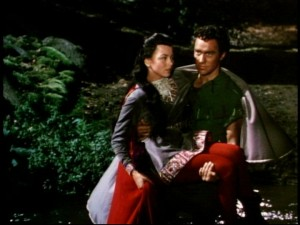 Robin keeps the maiden's feet dry as he returns her to the castle.