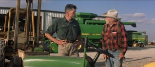 Such a journey calls for transportation, which leads Alvin to turn to Tom the John Deere Dealer (Everett McGill) for his approval on a 30-year-old riding lawnmower.