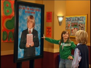 "Max (Alyson Stoner, a.k.a. Sally from ""Mike's Super Short Show"") shows Cole the newest ad in Zack's presidential campaign."