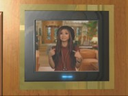 "Brenda Song hosts ""Sweet Lift Challenge"" from an elevator monitor screen."
