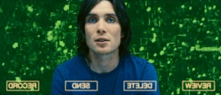 Robert Capa (Cillian Murphy) records a video message for his relatives back on Earth.