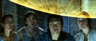 Corazon (Michelle Yeoh), Capa, Trey (Benedict Wong), and Cassie (Rose Byrne) take a look their high-tech flight plan.